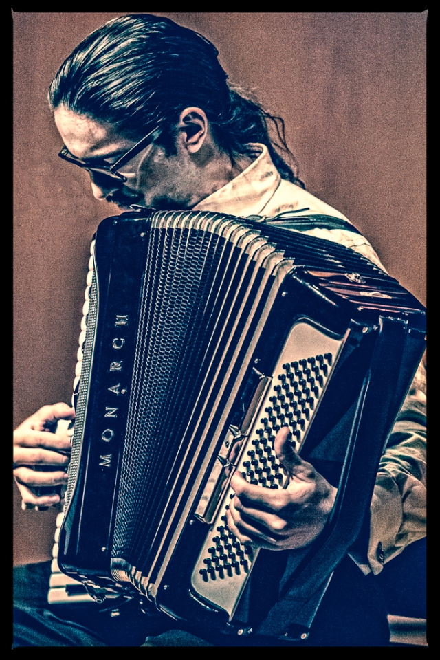 Portrait of emerging composer Jackson Alexander Parodi with his accordion